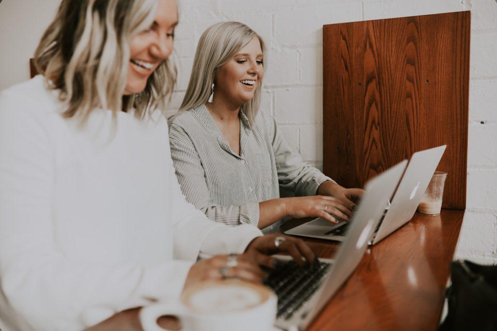 Two women in HR working side by side on Learning & Development plans